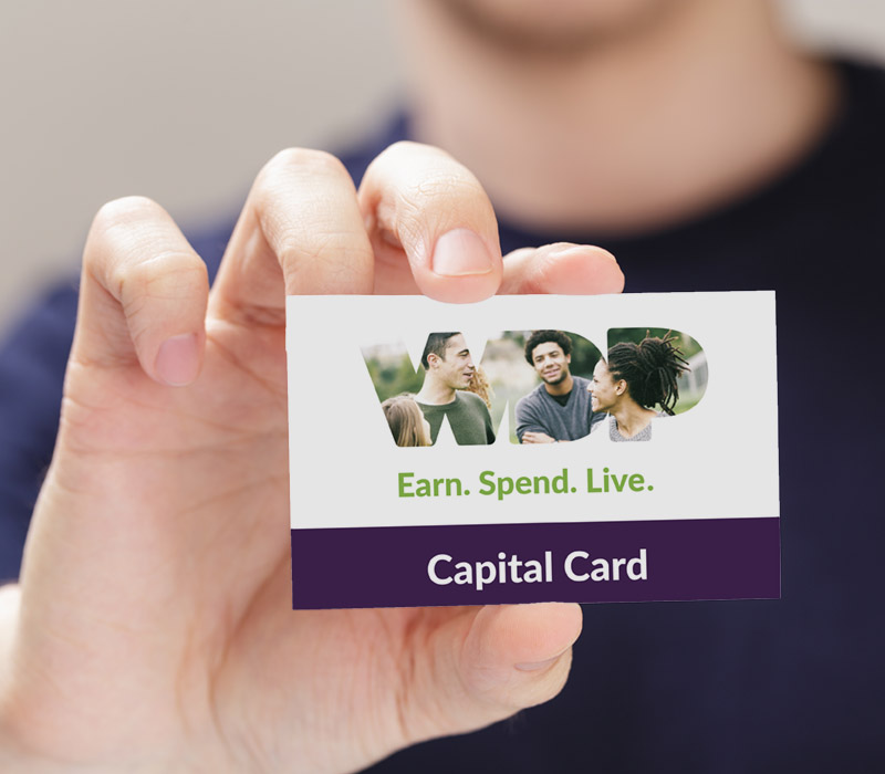 Man holding the Capital Card
